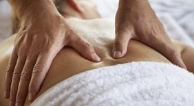 Woman Getting Therapeutic Massage --- Image by © Mina Chapman/Corbis